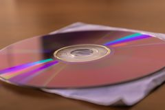 CD DVD disc on white paper cover box closeup. Image royalty free stock photos