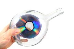 CD or DVD in the glass bottle Stock Image