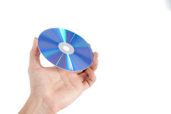 CD and DVD. Hand holding dvd on white background royalty free stock images