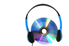 CD or DVD with headphones Royalty Free Stock Photography