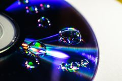 CD DVD MET WATERdalingen royalty-vrije stock afbeelding