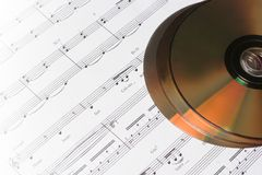 CD or DVD with musical note. Musical concept - CD or DVD with musical note Royalty Free Stock Image