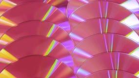 CD DVD schijf glanst de kleurrijke compacte regenboog als achtergrond plastic roze viooltje stock afbeeldingen