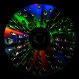 CD dysk z wodnymi kroplami zdjęcia stock