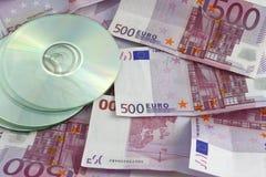 Cd e dinheiro Fotografia de Stock Royalty Free