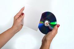 CD e la sua tasca bianca immagine stock libera da diritti
