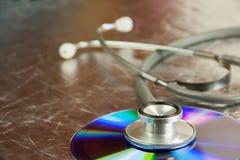 CD e stetoscopio del disco Fotografia Stock Libera da Diritti