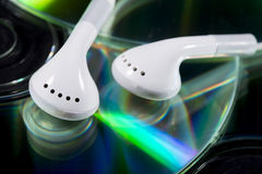 Cd and earphones Royalty Free Stock Image