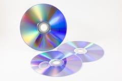 CD en el fondo blanco fotografía de archivo libre de regalías