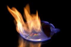 Cd en el fuego Imagenes de archivo