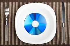 Cd en la placa del alimento Imagen de archivo