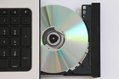 CD en un ordenador Fotografía de archivo libre de regalías