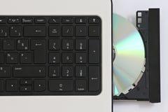 CD en un ordenador Foto de archivo