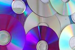 CD för dvdsbakgrund för dvd reflekterande skinande cd modell för textur Arkivbilder