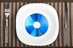 Cd on food plate Stock Image