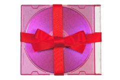 CD gift tied with red satin ribbon. Isolated on white background Royalty Free Stock Image