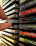 CD Grip. Taking out CD from vertical rack NOTE: All clearly visible names and sleeve designs done by myself stock photos
