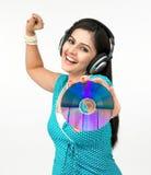 cd hörlurar med mikrofonkvinna Fotografering för Bildbyråer