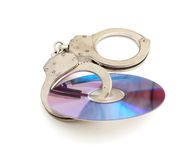 Cd with handcuffs Royalty Free Stock Image