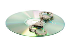 Cd with handcuffs Stock Photos
