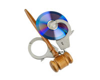 Cd with handcuffs and gavel isolated Royalty Free Stock Image