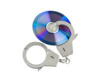Cd with handcuffs isolated Royalty Free Stock Images
