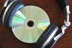 CD with Headphones. A pair of headphones with a CD Stock Photography
