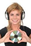 cd holdingkvinna Royaltyfri Fotografi