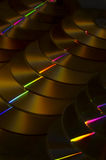 CD. Horizontally stacked CDs with golden light stock image