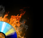 Cd hot. Burninging disk on colour background Royalty Free Stock Photography