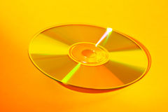CD jaune Photo libre de droits