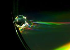 CD kant med vattendroppe Fotografering för Bildbyråer