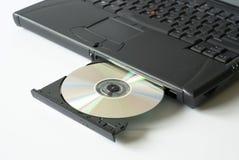 CD in laptop schijfaandrijving Stock Foto's