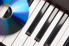 CD Laying on Piano Keyboards Abstract Stock Photos