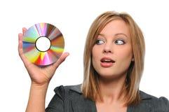 CD lindo da terra arrendada da mulher de negócios Fotografia de Stock
