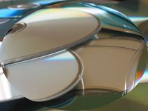 CD mess 6. View through magnifying glass Royalty Free Stock Photo