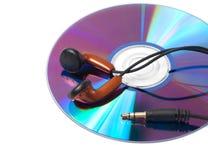 CD met muziek en hoofdtelefoons Stock Foto