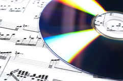 Cd and musical score Royalty Free Stock Photos