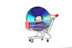 CD na cesta de compra imagens de stock