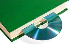 CD no livro imagem de stock