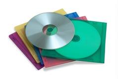 CD o DVD en cajas plásticas coloridas imagen de archivo