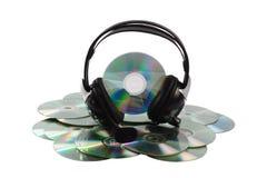 Cd och headphone. arkivfoton