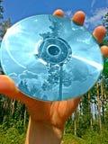 CD och reflexioner arkivfoto