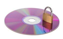 CD ou DVD avec un cadenas fermé sur le dessus photo libre de droits