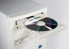 CD ou DVD et ordinateur Images stock