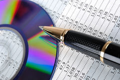CD, pen and data sheet. A compact disk and a ball pen putting on a data sheet, means data storage and analysis business concept Stock Photo