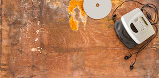 CD player on brown wood background for listen. Stock Image