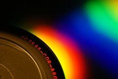 CD-r med den flerfärgade regnbågen Royaltyfri Foto