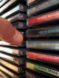 CD Rack Grip. Taking out CD from vertical rack NOTE: All clearly visible names and sleeve designs done by myself stock photography