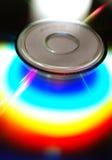 CD rainbow flare. Full light spectrum on a cd quarter, black background Stock Photos